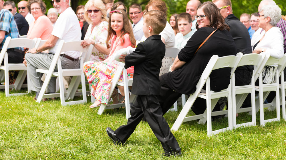 Ring-bearer-Wedding-outdoor-ceremony.jpg