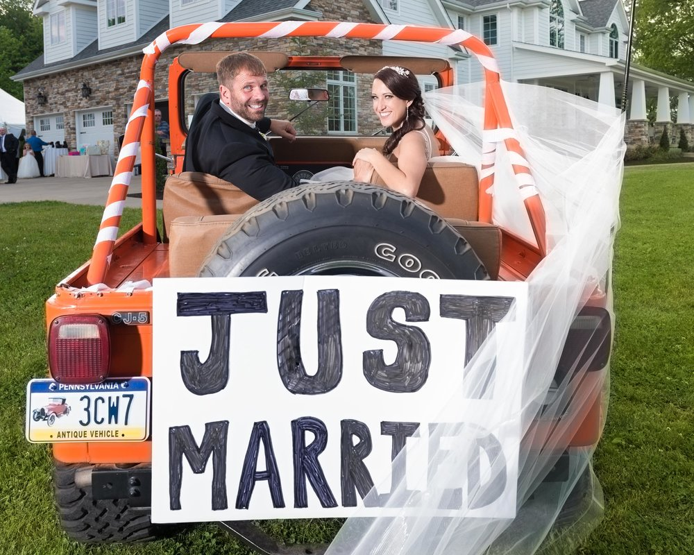 Bride-and-Groom-just-married-sign-in-jeep.jpg
