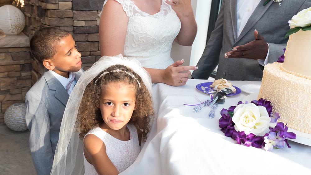 Cutting_the_cake_Flower_Girl.jpg