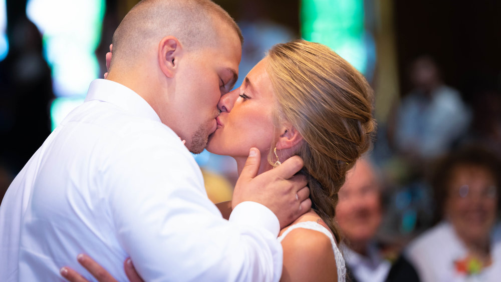 Bride-and-groom-first-kiss-mayernik-center-2.jpg