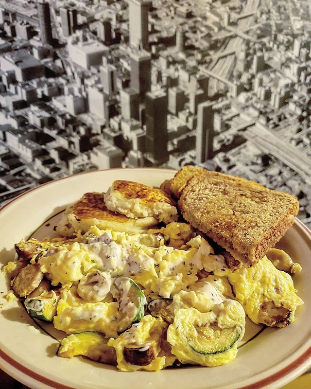 "Our ""Jeremy's Jubilee"" scramble consists of chicken sausage, grilled zucchini, roasted garlic, and our rosemary-thyme herby goat cheese. Its ...... just really good."