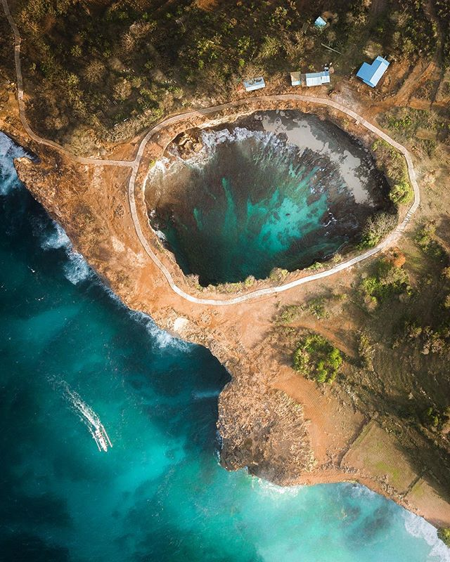 This is an amazing shot by my friend  Harry  is taken at Broken Beach. You can take a stroll along that path, and there are manta rays near that area. I unfortunately had a Mavic Air at the time and it was way to windy to fly my drone up, so big thanks to Harry!