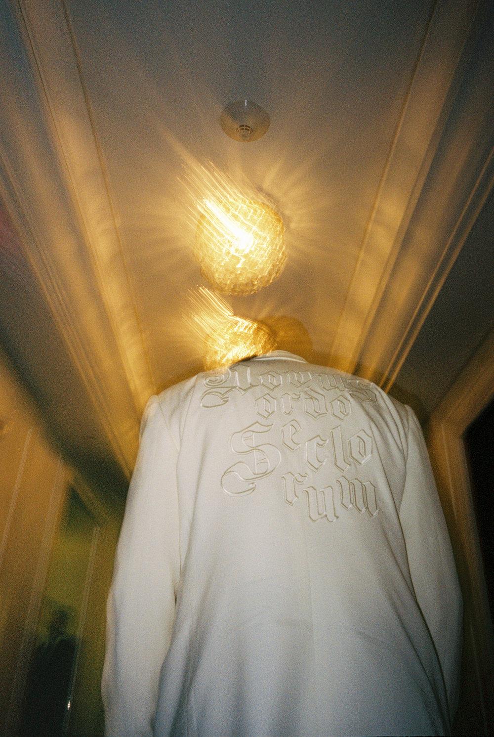 """Custom Embroidered Ivory Tuxedo Jacket reads """"NOVUS ORDO SECLORUM"""""""