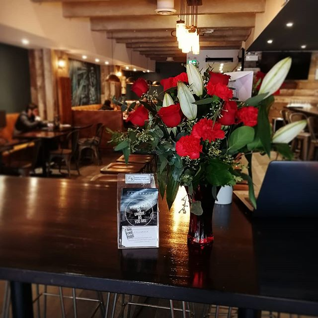 Someone very lucky at our @theelliskits location is feeling the Valentines love today thanks to their partner sending them a little present. They are currently blushing as red as the roses! 🌹#Valentines #coworking #kitsilano #thisfreespace #love #onbrand #roses #vancouverisawesome #vancouverrestaurants