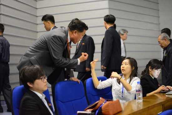 Korean-American and North Korean scientists discussing medical research at the 2017 Pyongyang Medical Conference, hosted in Pyongyang, Democratic People's Republic of Korea