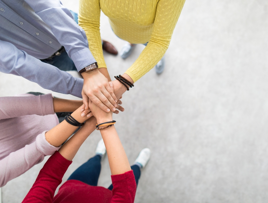 Stack-of-hands.-Unity-and-teamwork-concept.-882292568_1569x672.jpeg