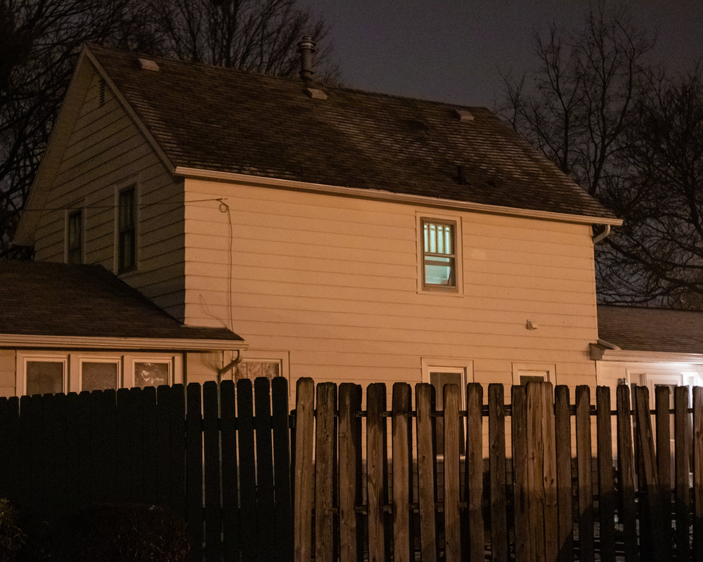 Inspired by    Todd Hido'   s work, this image suggests a narrative, even without any humans present in the scene.