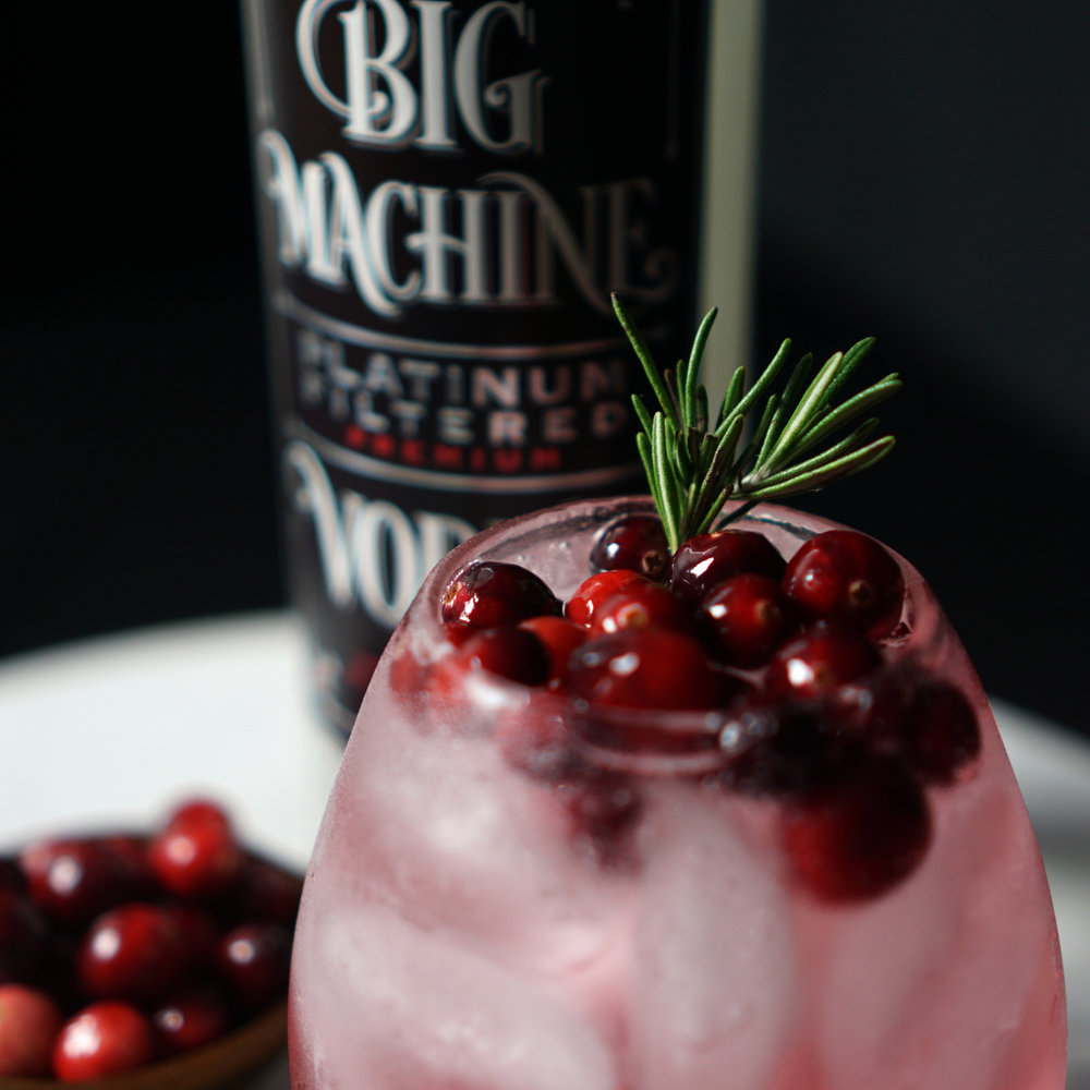 holiday big machine - 2OZ BIG MACHINE VODKA6OZ TONIC WATERSPLASH OF CRANBERRY JUICEICEGARNISH WITH:VODKA SOAKED CRANBERRIES