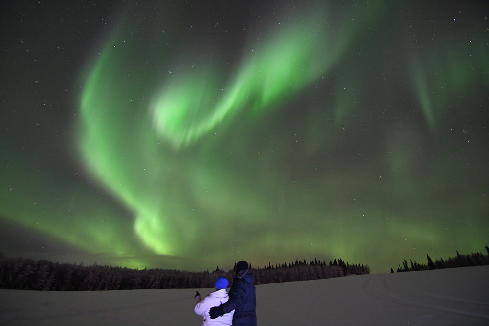 Enjoy a complimentary portrait under the Aurora, taken by your very own guide. -