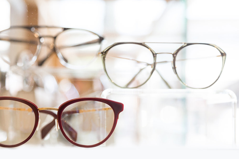Picture of glasses on shelves in the windowAdd title