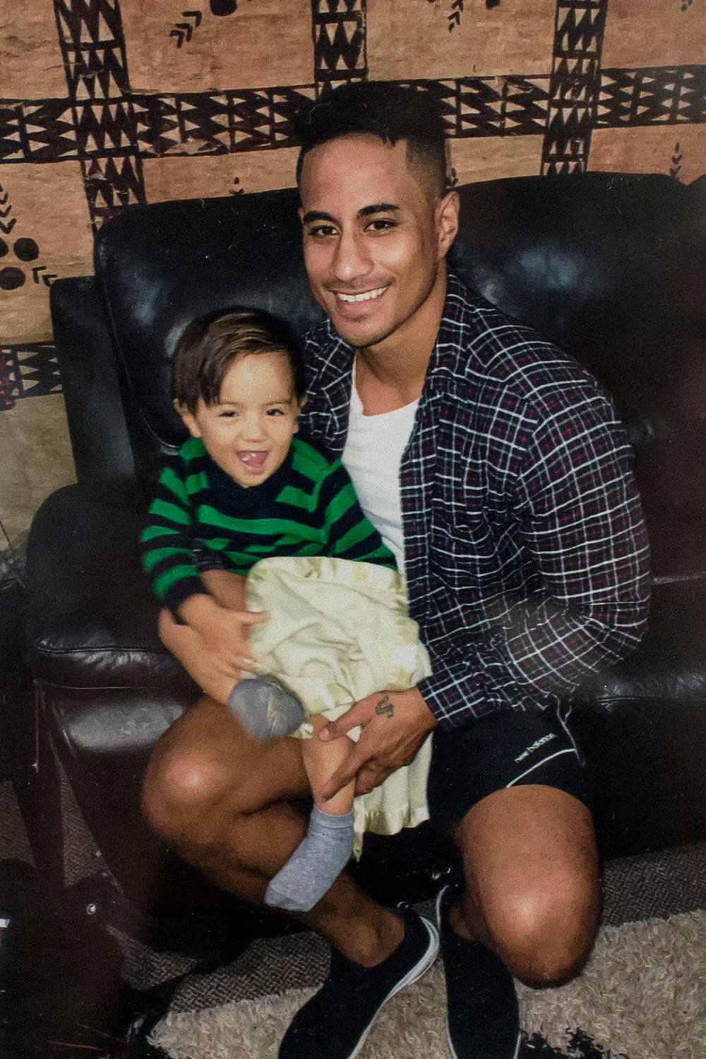 Lafaele Stowers, a New Zealand citizen originally from Samoa, with one of his three children. Mr. Stowers has been in a Sydney detention center for more than a year while appealing the cancellation of his visa.