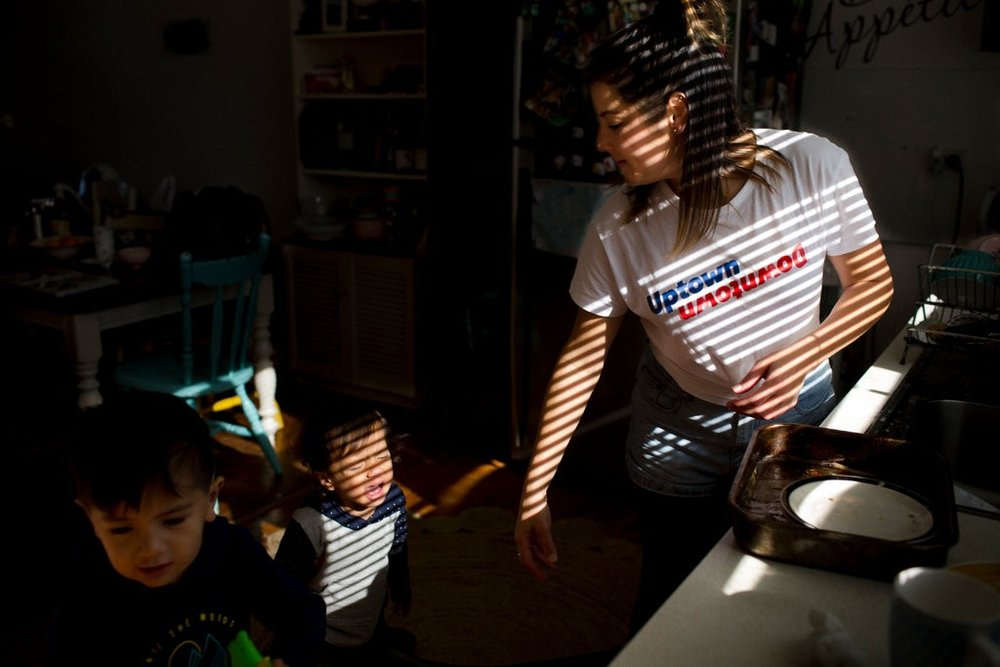 Renay Heng, Mr. Stowers's partner, preparing to take their sons Isaiah, 3, and Zion, 1, to visit him in the detention center. Credit: David Maurice Smith for The New York Times