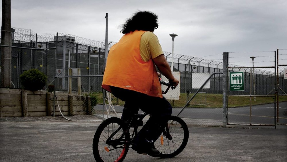 A Paremoremo prisoner tests out one of his bikes. Credit: David White Fairfax Media