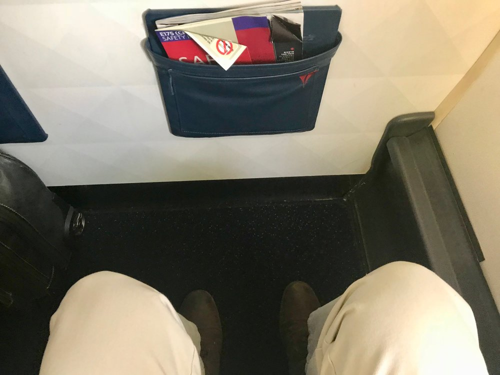 There is more knee space in 1D than other rows in the First Class cabin. However, there is no under seat stowage and you cannot stretch your legs as far as in other rows.