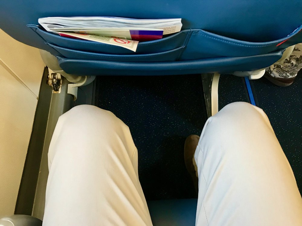 There is not as much knee space as Row 1, but there is more room to stretch your legs. There is also under seat stowage.