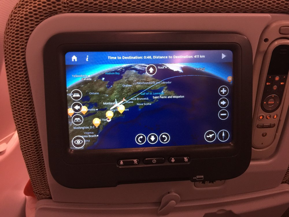 The seat-back screens were a good size. I had some work to do on the flight, so I didn't really do much with the IFE (in flight entertainment), but it looked like there was a sizeable selection. There was also a USB charger just under the screen.