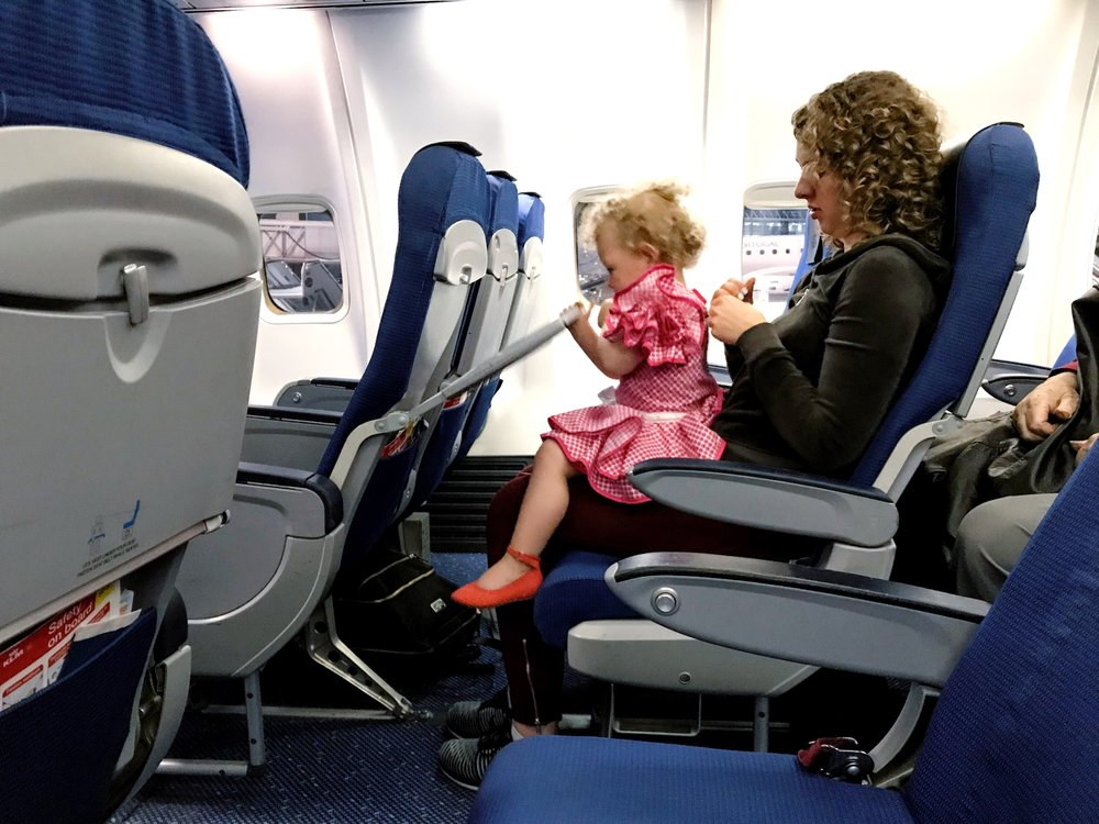 The seats in Business Class were the same width as Economy, but offered slightly more legroom. They aren't the same as domestic First Class seats in the United States. The cabin has sliding partitions that allow for more or less Business Class seats as demand changes. There were four rows of Business Class on this flight, allowing for 16 passengers (the center seats remain empty in Business Class). Aside from my wife, daughter and me, there was only one other passenger in Business Class, which made for incredibly personalized service.