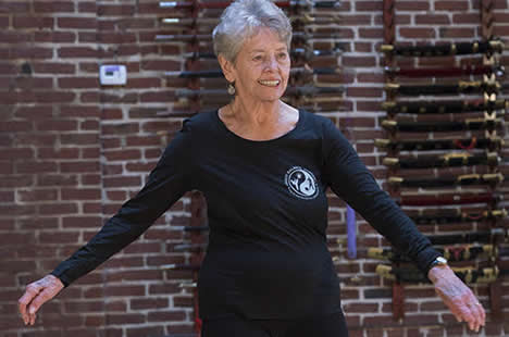 """our programs - """"I attribute my stamina throughout my cancer treatment to having strengthened my body by practicing Tai Chi."""" - Pat N., member of Support For Healing Group"""