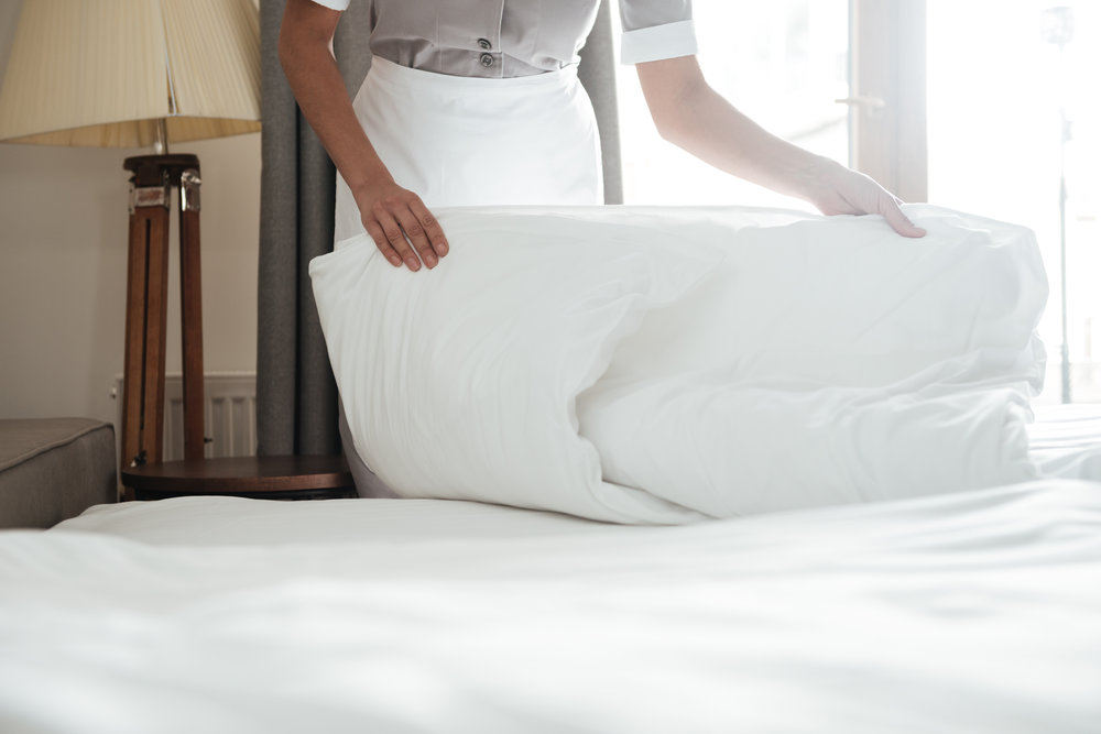 cropped-image-of-a-chambermaid-making-bed-in-PSHHAYP.jpg