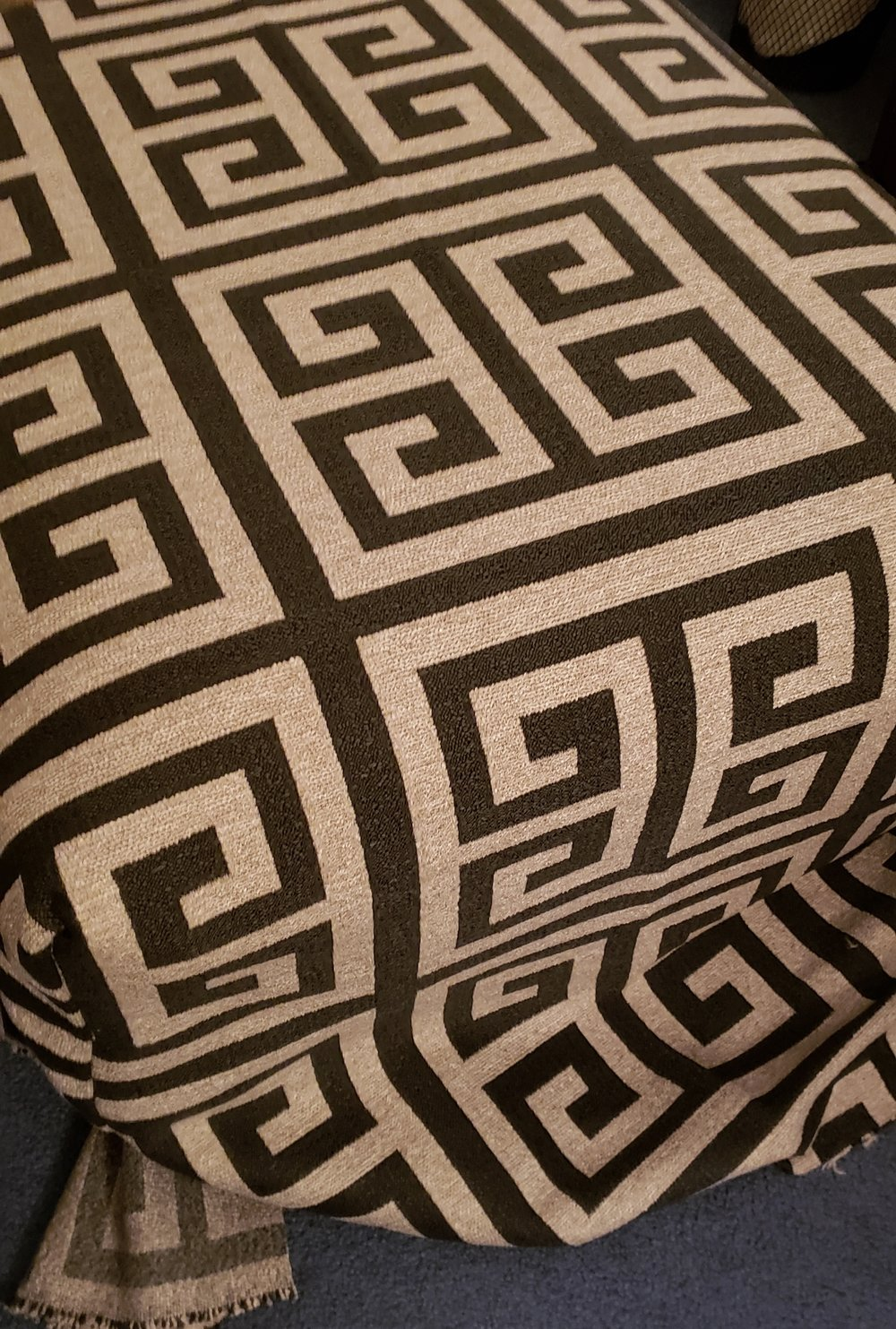 step five - Place the sewn cover over the ottoman with the correct side of the fabric facing out now. Check all four corners to see if they line up correctly and are taut enough. Also, are there any wrinkles elsewhere? Now is the time to make adjustments prior to stapling.