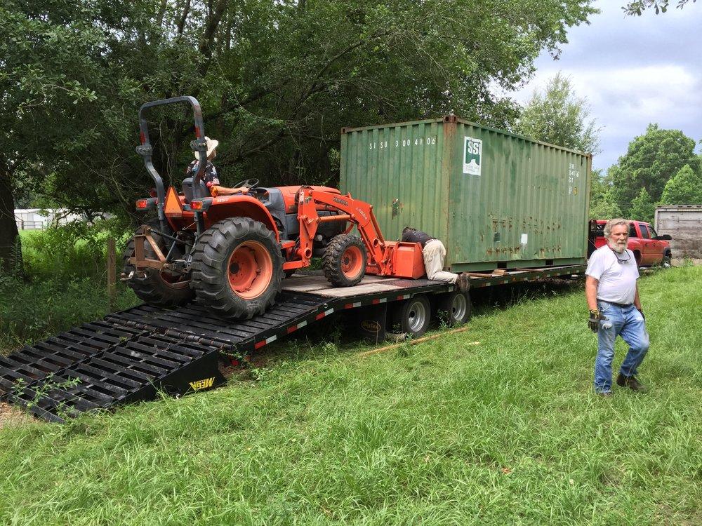 Steve Ritter helping Doug unload container.jpg