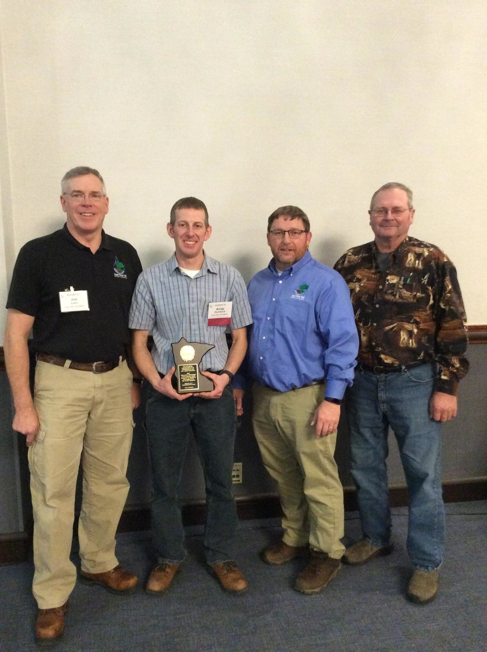 Sharing in honoring Andy Dombeck are Jim Lahn, Area Certification Specialist (left), MAWQCP Program, Andy Dombeck, Conservation Farmer, Darren Newville, District Manager for the East Otter Tail & Wadena SWCDs and Lyle Dittmann, East Otter Tail SWCD Board Chairman. Submitted photo