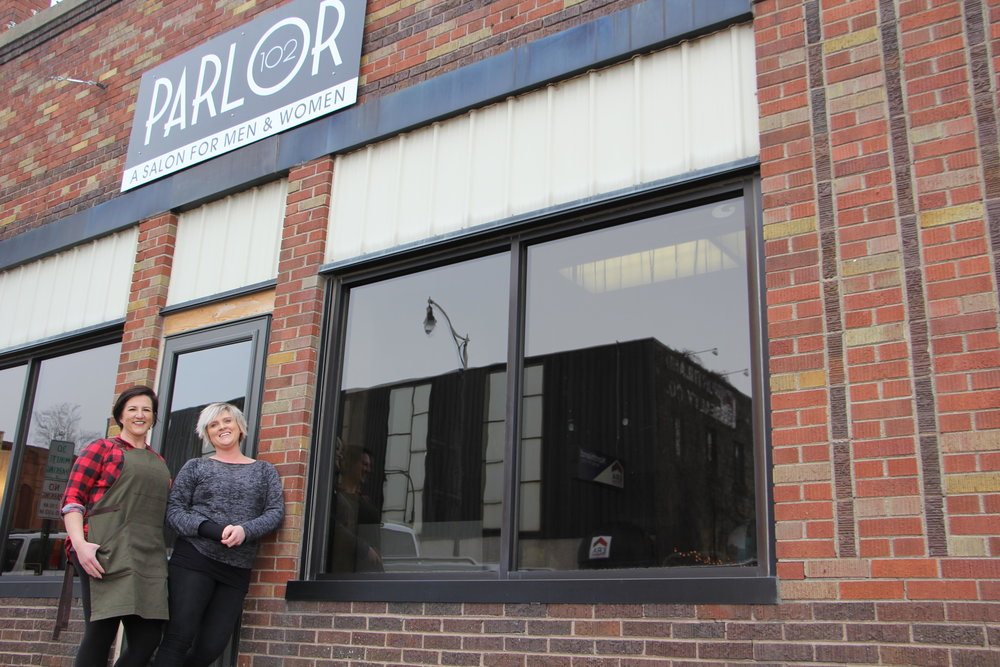 Katie Schiller (left) and Jen Metelak (right) stand outside of their new salon, Parlor 102. Kaysey Price / Tribune