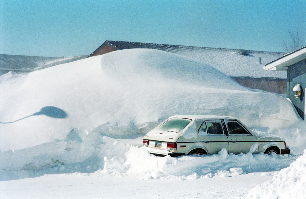 A mountain of snow between houses in 1997. Forum News Service file photo