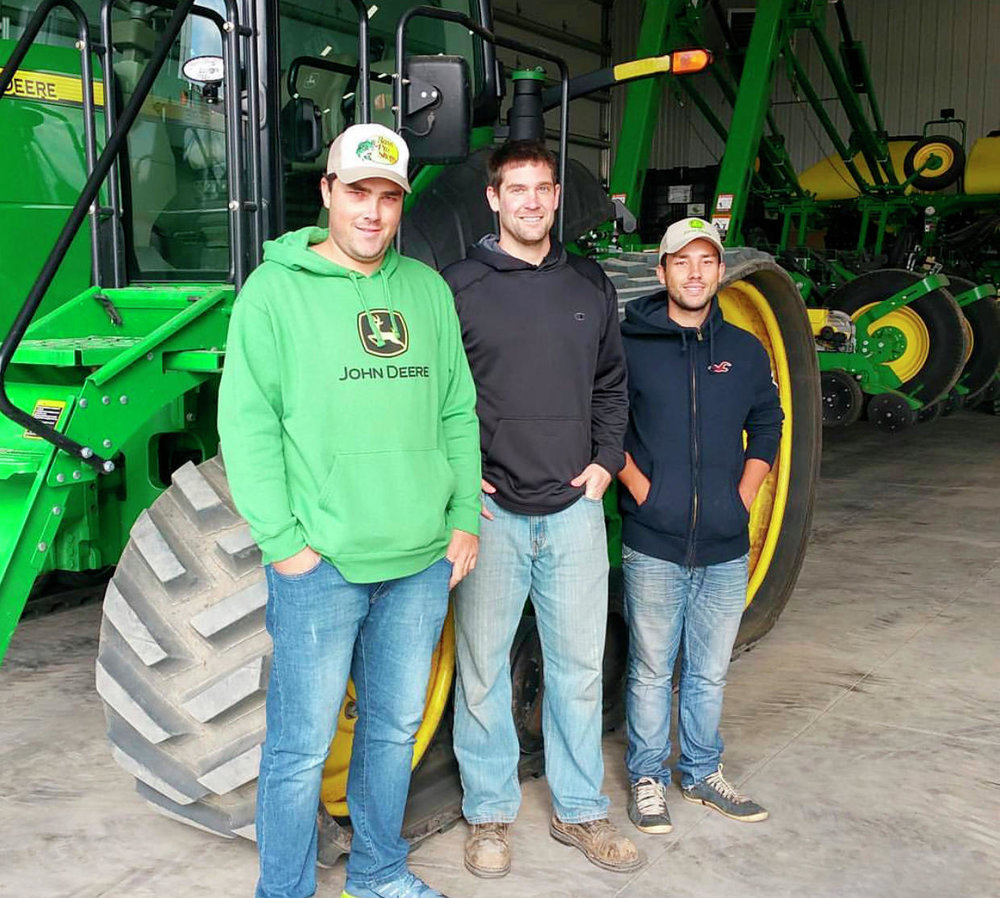 Johnson (middle) welcomes his Brazilian pen pals Raphael (right) and Guilherme left) to his farm in April 2017. Johnson remains in contact with his foreign friends today. (Contributed)