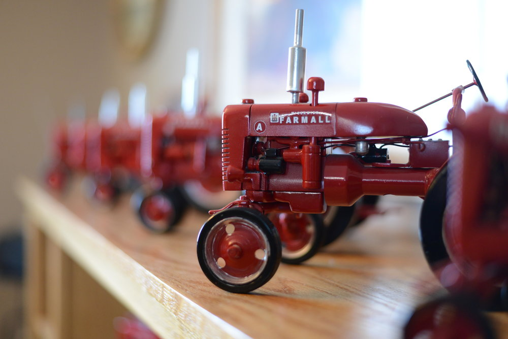 Rod Swanson's tractors sit on display in his Perham home. Swanson works on four tractors at a time and numbers each one. (Carter Jones / FOCUS)