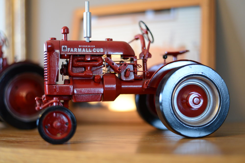One of Rod Swanson's tractors sits on display in his Perham home. Swanson starts each project with raw steel and references up to 50 photos to include every little detail. (Carter Jones / FOCUS)