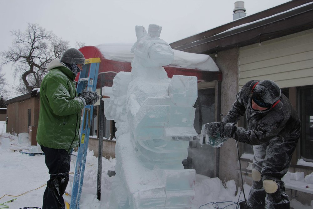 "Ice carving team Trevor Pearson and Nick Lensing were already hard at work on their ""Bucking Cowboy"" sculpture early Saturday morning; all that work paid off, as their sculpture took first place in the judging for the inaugural Multi-Block Ice Carving Competition, held later that afternoon. (Vicki Gerdes / Tribune)"