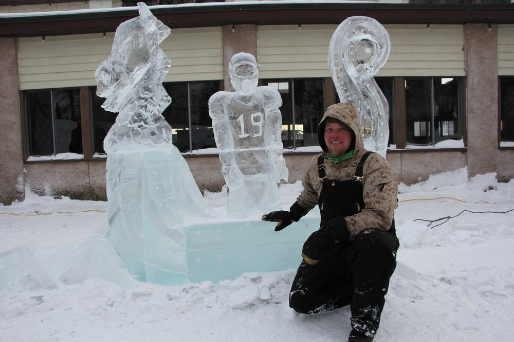 "Though he didn't take one of the top three spots in this weekend's ice carving competition, ""Chainsaw Dave"" Belling, Moorhead, was pretty proud of his ""Home Voyage"" sculpture, which featured hometown hero Adam Thielen. (Vicki Gerdes / Tribune)"