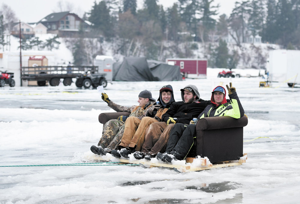 Eelpout Festival goers hitch a ride on a couch pulled by an all-terrain vehicle during last year's annual Eelpout Festival on Leech Lake. Forum News Service file photo