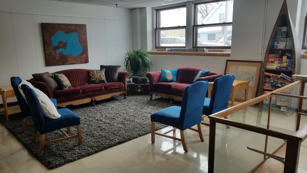 This comfortable lounge area, complete with a painting of Big and Little Detroit Lake in the background, is part of the new Holmes Art Cellar that will be showcased at an open house set for this Friday, March 9 from 4 to 7 p.m. (Vicki Gerdes / Tribune)