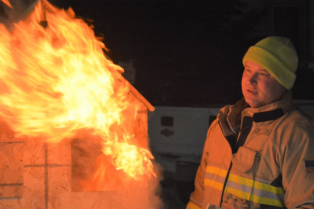 Training with a new infrared camera ended with the burning of a dollhouse designed to represent a residential home. Instructor Eric Makowski-Budrow leads the demonstrations. Michael Denny/Wadena Pioneer Journal