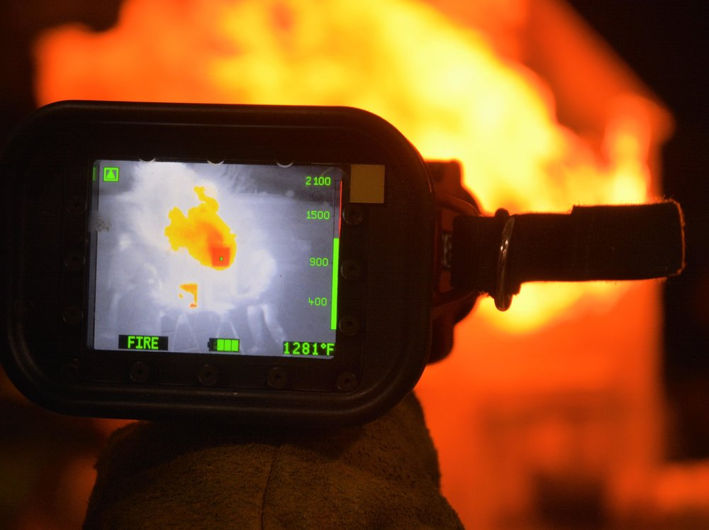 A fire fighter points the new camera at the mock blaze. Michael Denny/Wadena Pioneer Journal
