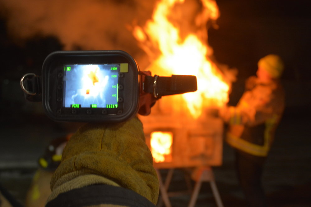Fire fighters took the chance to pass the camera around and play with the internal settings of the device, which show off the heat source and temperature. Michael Denny/Wadena Pioneer Journal