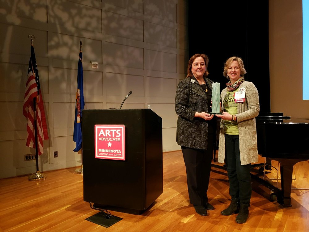 Historic Holmes Theatre Executive Director Amy Stoller Stearns, right, was presented with the 2019 Larry Award by Minnesota Citizens for the Arts Executive Director Sheila Smith during Arts Advocacy Day at the Capitol on Tuesday, March 12. (Submitted photo)