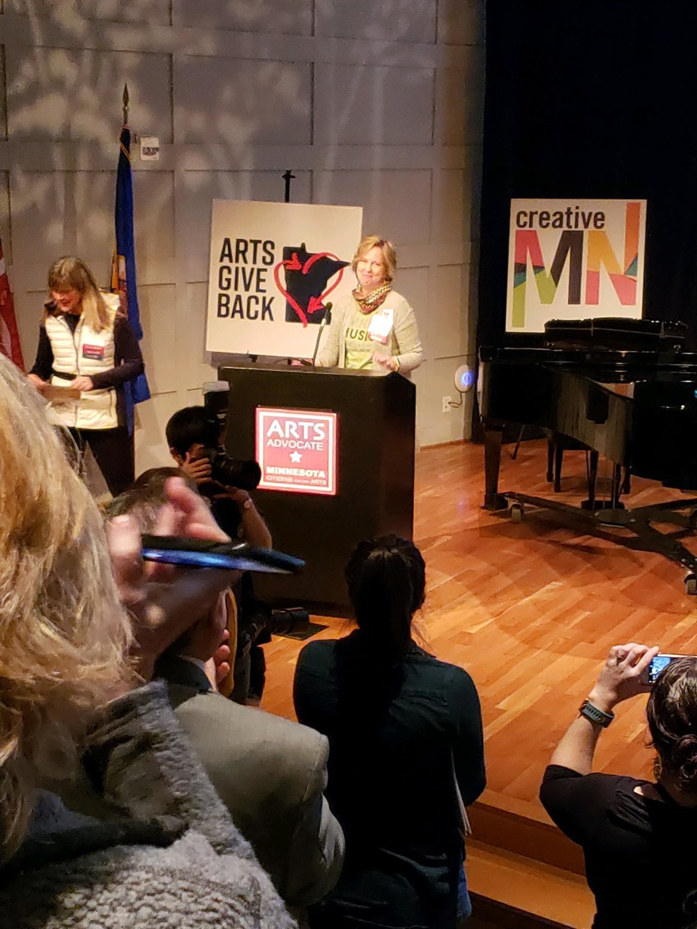 Holmes Theatre Executive Director Amy Stoller Stearns addresses the crowd at the Minnesota History Center after being presented with the Larry Award at Arts Advocacy Day on Tuesday, March 12 in St. Paul. (Submitted photo)