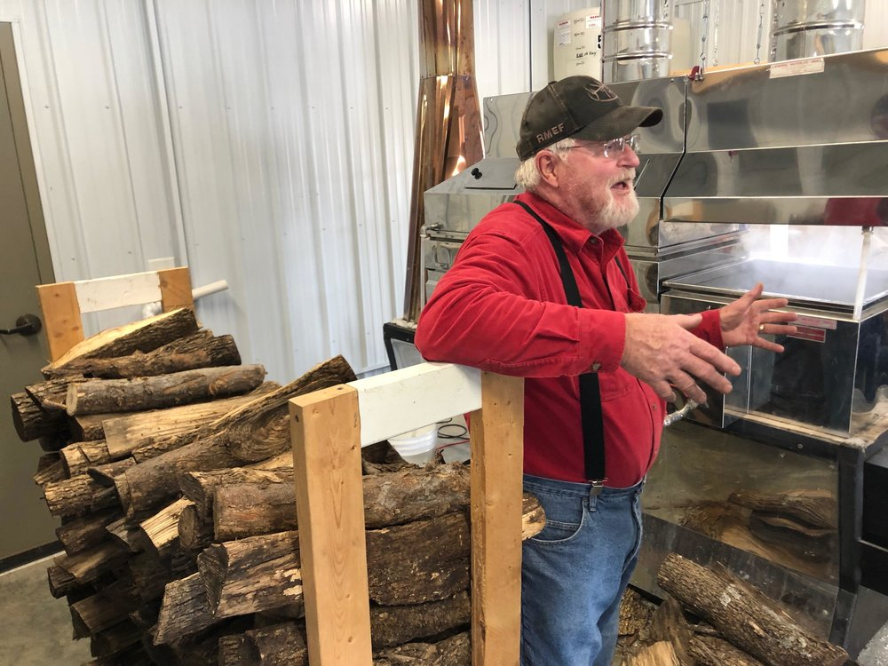 Bob Hanson, Friends of Maplewood volunteer and former Maplewood State Park manager, explains how 40 gallons of maple sap is boiled down to make 1 gallon of maple syrup. Katie Pinke / Forum News Service