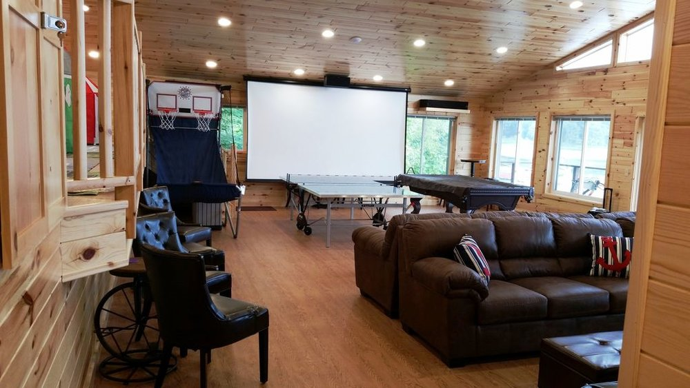 12-foot HD projector TV screen, Klipsch Surround Sound...great audio-video!