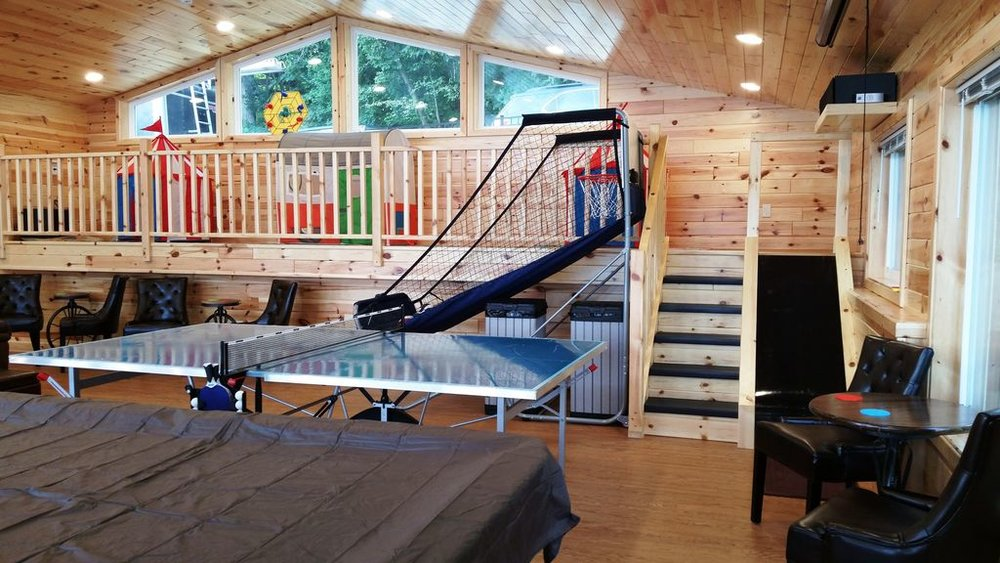 Access to the Kid's Play Loft is via staircase. Adjacent slide is a big hit!