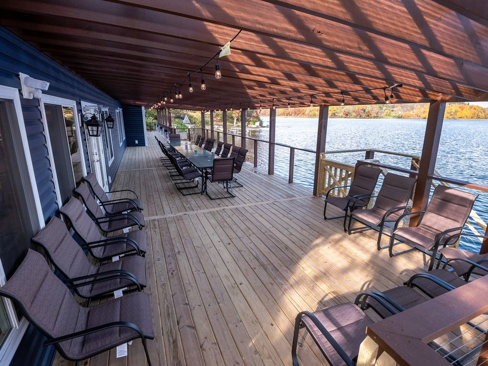 Deck + Patio below have total of 6 tables and 42 spring-action deck chairs.