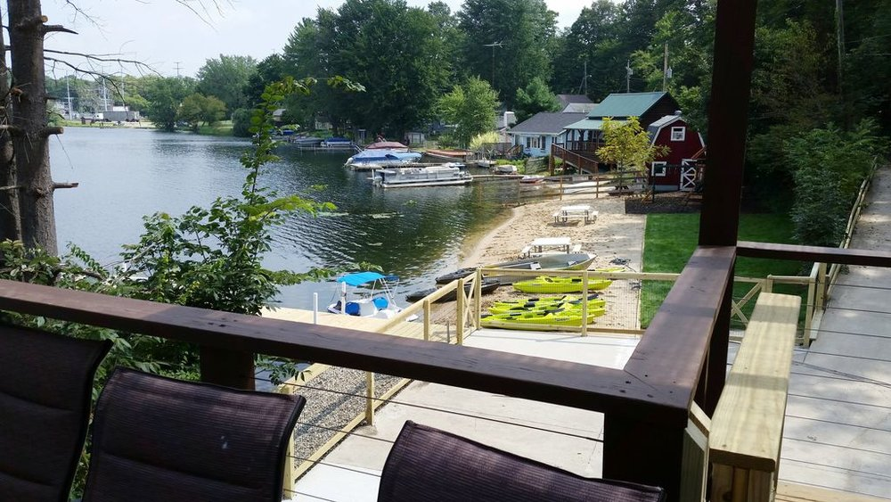 80 ft x 20 ft sandy gentle slope beach, 7 kayaks, row boat w/ lawn play area.