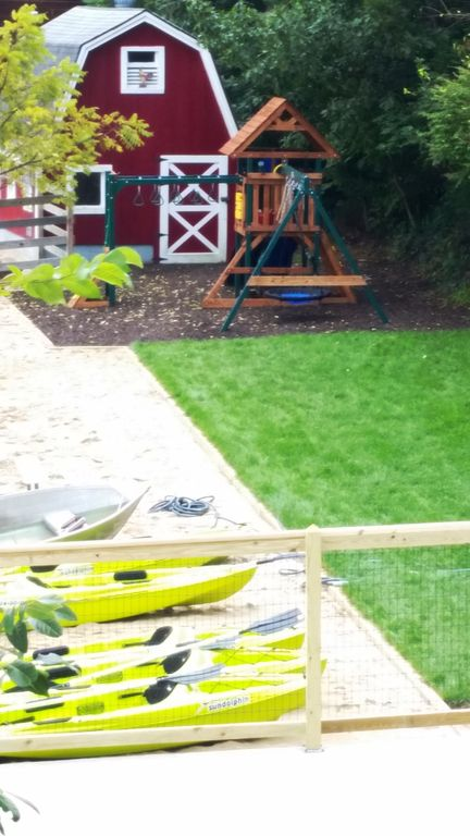 Lawn play area leads to kid's playscape. Barn has 15+ bikes, adults & child sizes