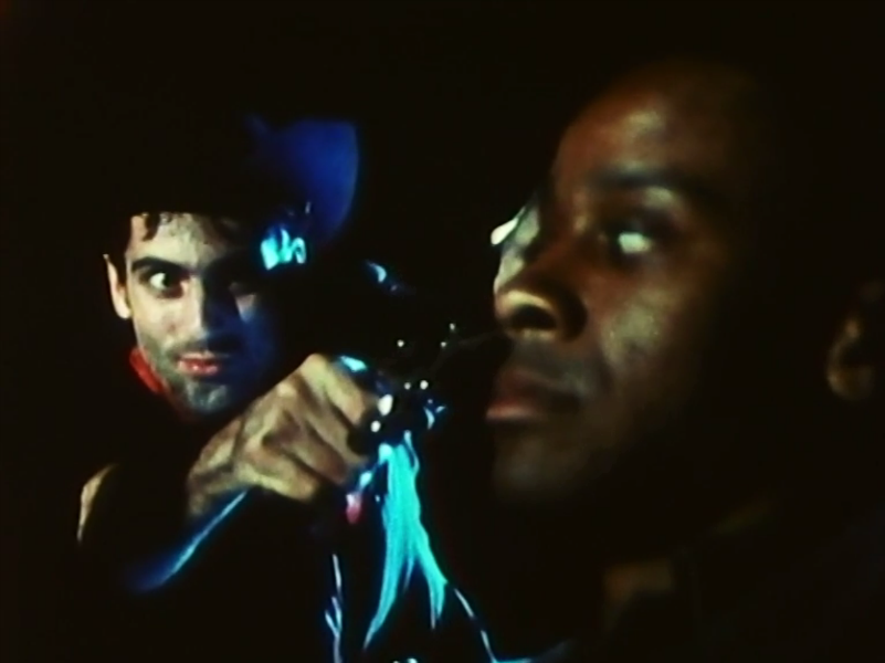 "Still from ""Nevada"" in the motion picture  Berlin Now  (1985): Christoph Dreher and Paul Outlaw"