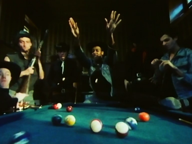 """Still from """"Nevada"""" in the motion picture  Berlin Now  (1985): Thomas Wydler, Jochen Arbeit, Remo Park, Paul Outlaw, Christoph Dreher and Rainer Lingk ( l to r)"""