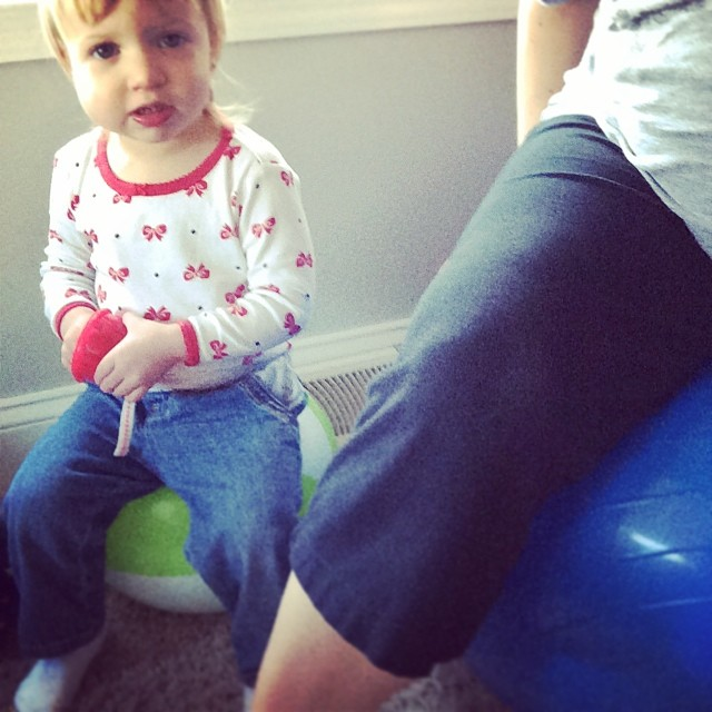 Mommy and daughter bouncing on the labor ball @ohbotherblog