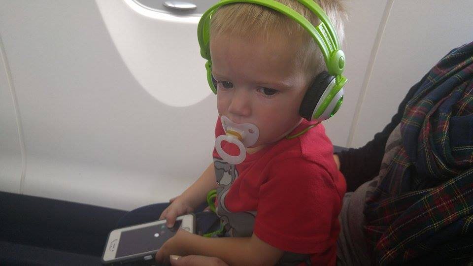 Kid headphones on a flight @ohbotherblog